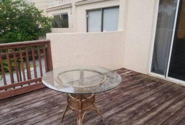 Wicker and glass Table (Pompano Beach)