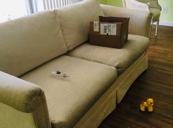 White upholstered love seat (Hallandale Beach)