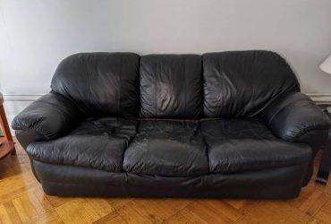 Black leather couch, broken in but super comfy (Harlem / Morningside)