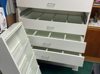 Free 8-drawer wood cabinet (Behind the Chick-fil-A and laundromat at the intersection of)