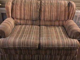 Fabric love seat (Jupiter, Florida)